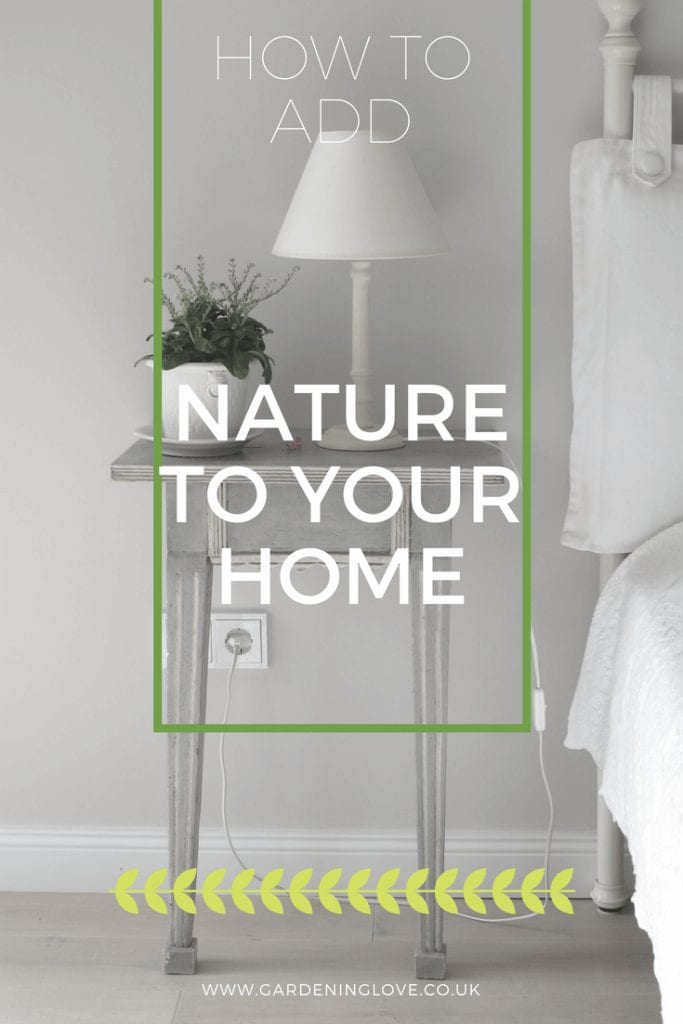 A bed and side table in natural colours with a green potted plant on the bedside table. 5 ways to bring nature into your home. Www.gardeninglove.co.uk